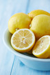 Lemons in a bowl; whole and halved