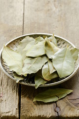 Dried bay leaves on a silver plate