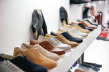 Variety of leather shoes in modern unrecognizable store poster