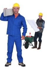 Man carrying a cement block