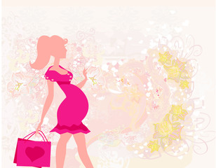 Beautiful pregnant woman on shopping - card