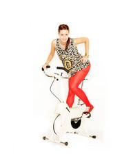 sportliche Frau auf Trimmrad