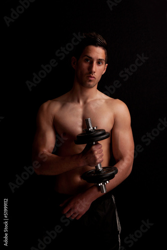 portret of a man with dumbbell in hand