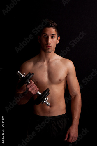 man with dumbbell in hand