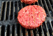 Raw Beef Hamburg Patty on the Grill