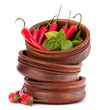 Hot red chili or chilli pepper in wooden bowls stack