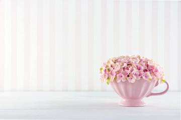 Flowers in a shabby chic mug