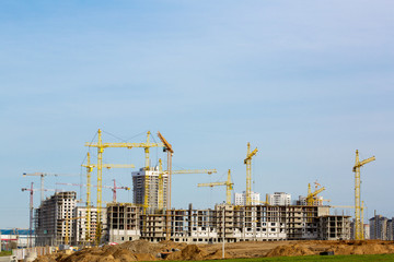 Construction site with cranes and buildings under construction