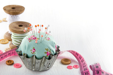 Pincushion in an antique  metal cupcake