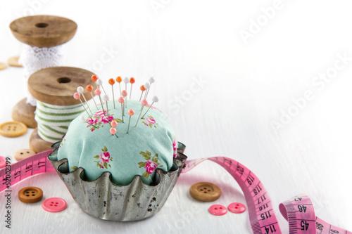Leinwandbild Motiv Pincushion in an antique  metal cupcake