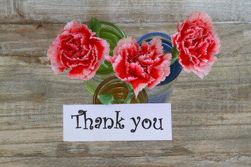 Thank you note with red and white carnations