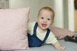 Very curious baby surprising stares while playing with pillows