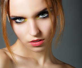 Magnetism. Character. Young Red Hair Beauty. Colorful Eye Makeup
