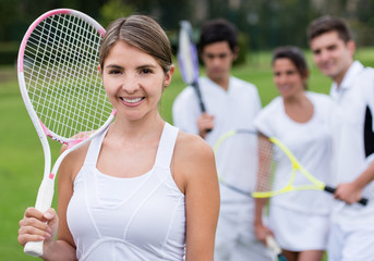 Female tennis player with her team