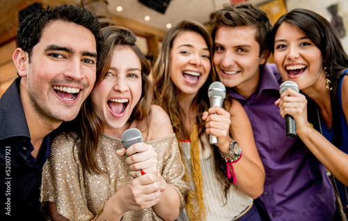 Group of friends singing