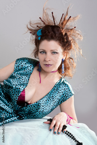 Fashion portrait of a redhaired woman. Hairstyle