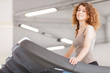 Woman is doing workout on a treadmill
