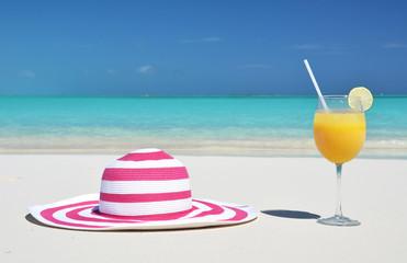 Hat and orange juice. Exuma, Bahamas