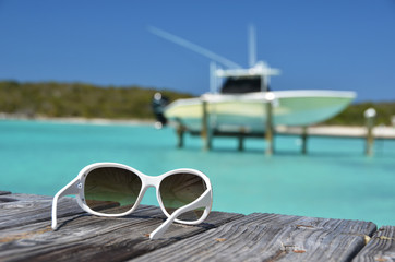 Sunglasses on the wooden jetty
