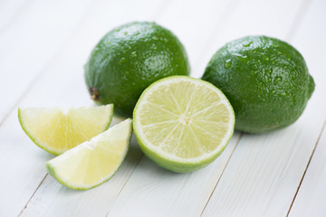 Ripe limes on wooden boards, horizontal shot