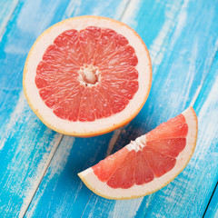 Ripe grapefruit on wooden boards, view from above, studio shot