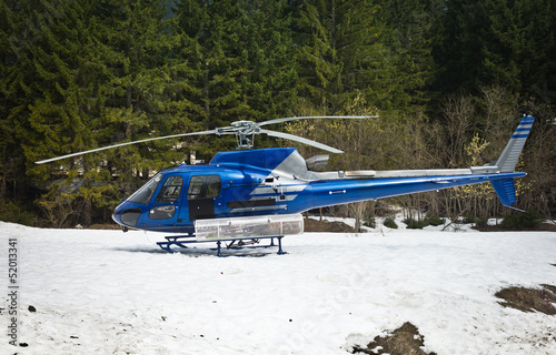 helicopter resting on the snow