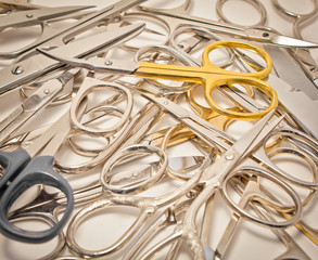 many sewing scissors on white -square
