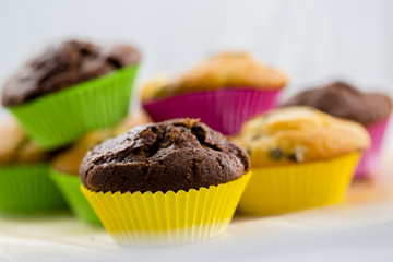 Muffins - homemade cupcakes in colorful molds