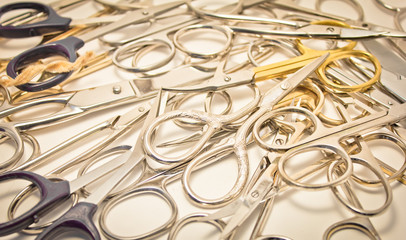many sewing scissors on white