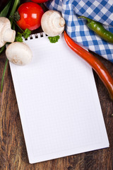 Notebook of vegetables on the table