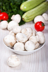 Mushrooms, zucchini and other fresh vegetables on the table