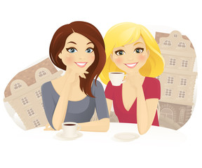 Two woman drinking coffee in street cafe
