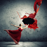 Ballet dancer in flying satin dress with umbrella
