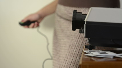 Retro styled footage with audio of a woman with slide projector