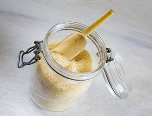 brown sugar in a glass jar, selective focus