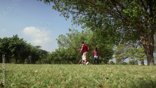 Children playing soccer game, group of friends with football