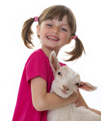 happy little girl with little goat