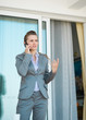 Business woman talking mobile phone on terrace