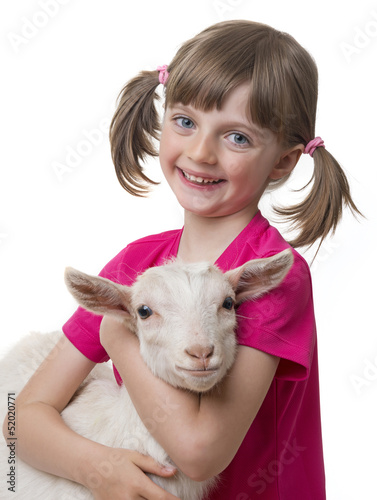 happy little girl with little goat isolated on white background