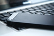 device technology. black phone and laptop keyboard