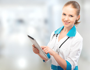 woman Doctor holding a tablet computer