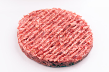 raw steak burger isolated on white