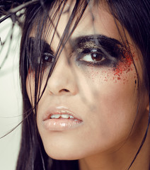pretty woman with make up like demon