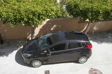 Overview of a parked small black car