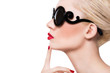 Beautiful blonde girl in sunglasses with red lips on white backg