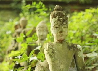 Ancient broken Buddha statue,U-Mong temple,Chiang-Mai,Thailand.