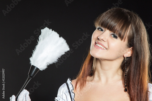 Smiling girl with duster