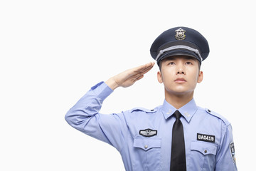 Police Officer Saluting, Studio Shot