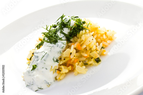 White rice with garlic sauce on a plate  on white background