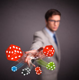 Attractive man throwing dices and chips